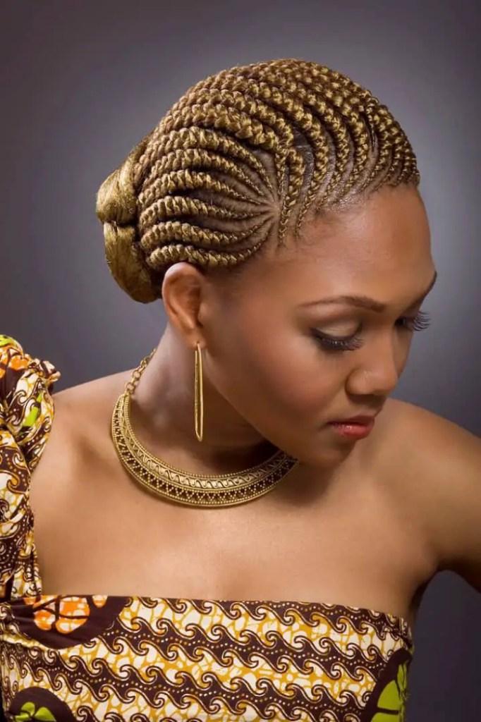 lady wearing brown weaves Ghana weaving