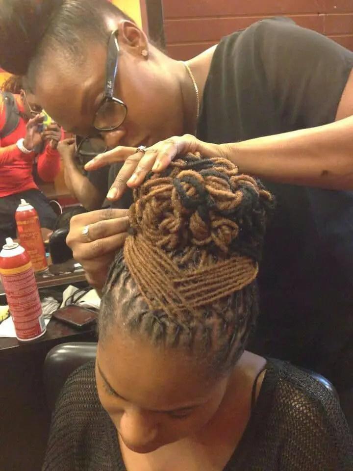 lady styling dreadlocks hairstyle