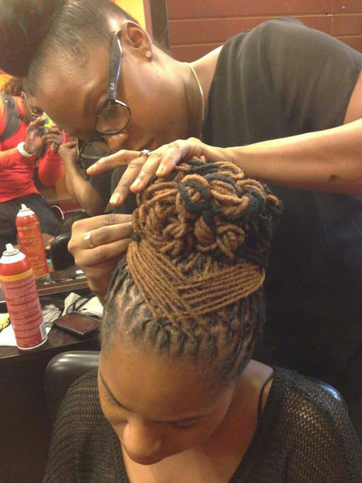 Lady caring for her dreadlocks hairstyle
