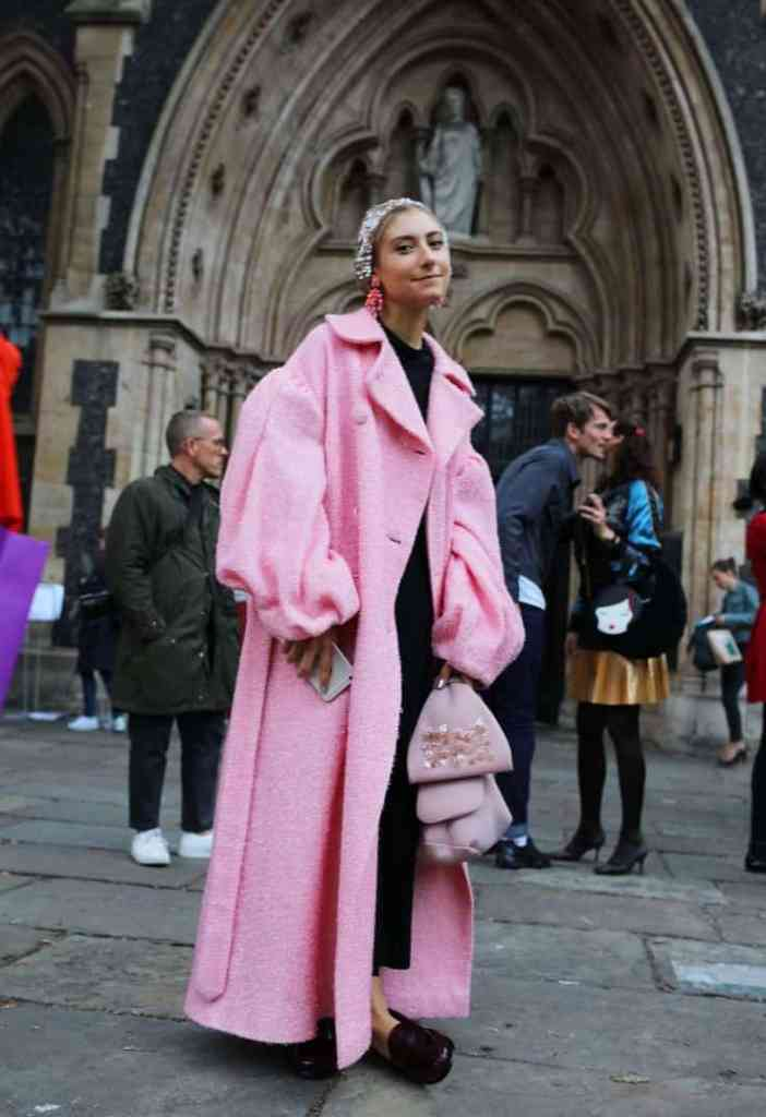 lady wearing a pink statement overcoat