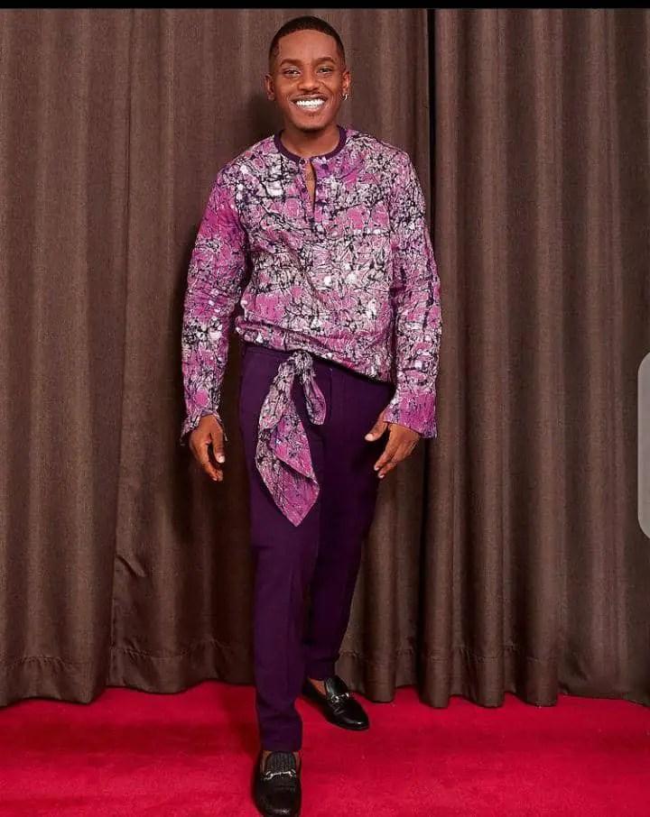 smiling man wearing a statement shirt