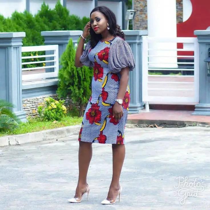 lady wearing mixed ankara fabrics gown