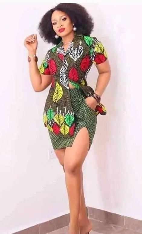 fair lady wearing different ankara top and short skirt