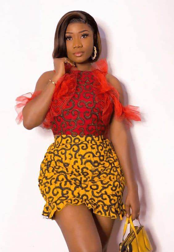 lady mixing related pattern ankara in her outfit