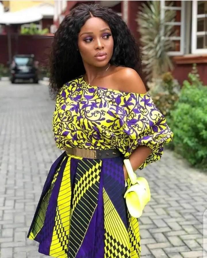 beautiful lady wearing similar color ankara mix outfit