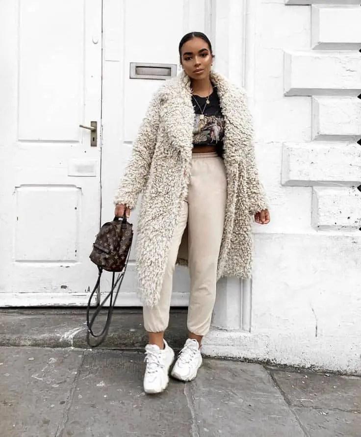 lady wearing a white fur coat
