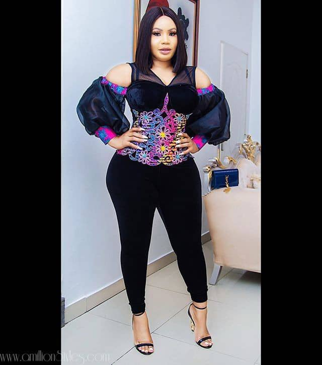 lady wearing ankara top mixed with other fabric