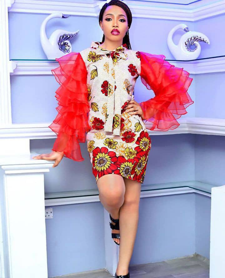 pretty lady wearing ankara dress with organza sleeves