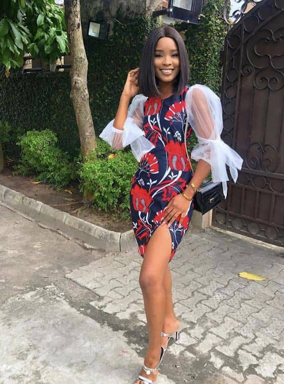 pretty slim lady wearing ankara and organza short dress