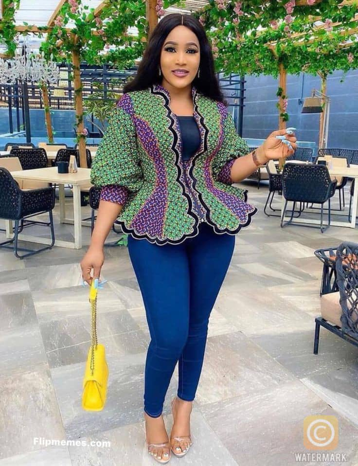 lady wearing ankara peplum top with jeans