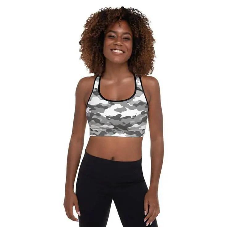 smiling lady wearing army sports bra
