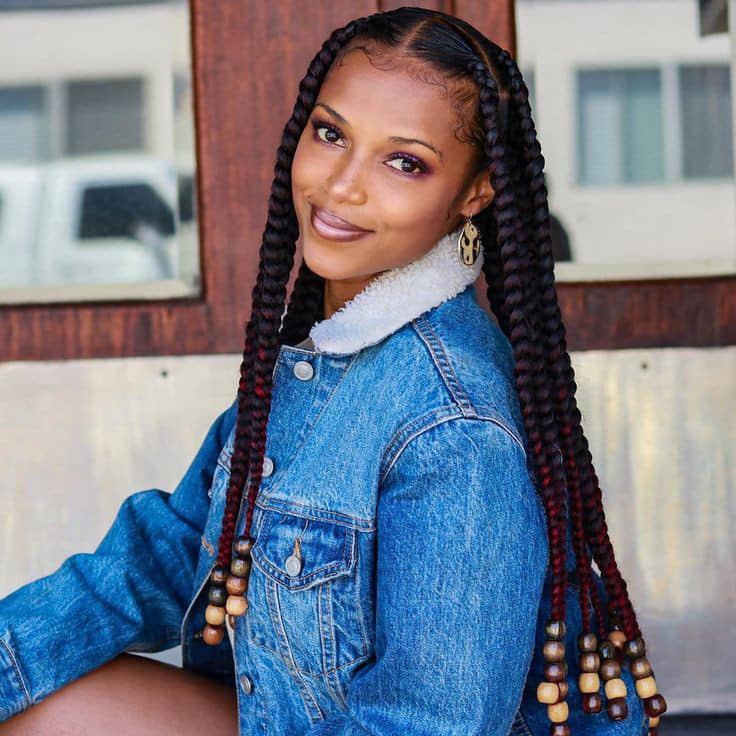 lady in big knotless braids with beads