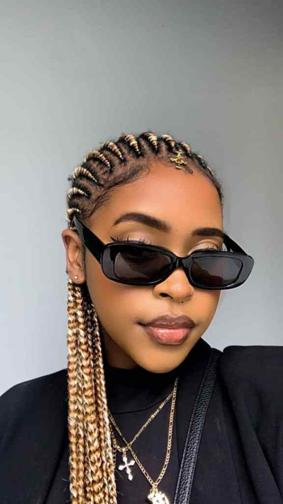 lady wearing gold all-back cornrows with shades