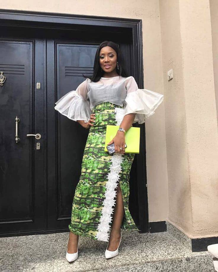 lady wearing organza top with ankara midi skirt