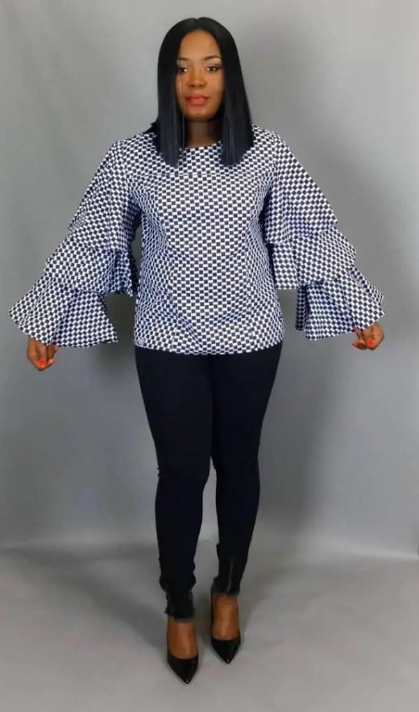 lady wearing long sleeves ankara top