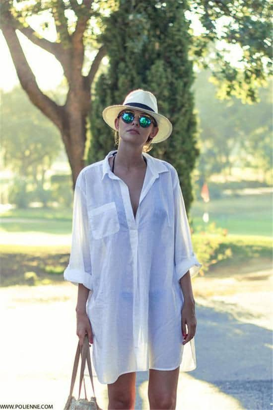 lady wearing shirtdress and sunglasses to the beach