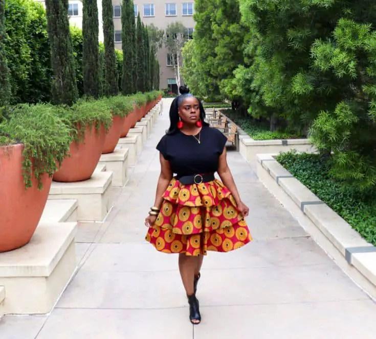 lady wearing ankara skirt with black top