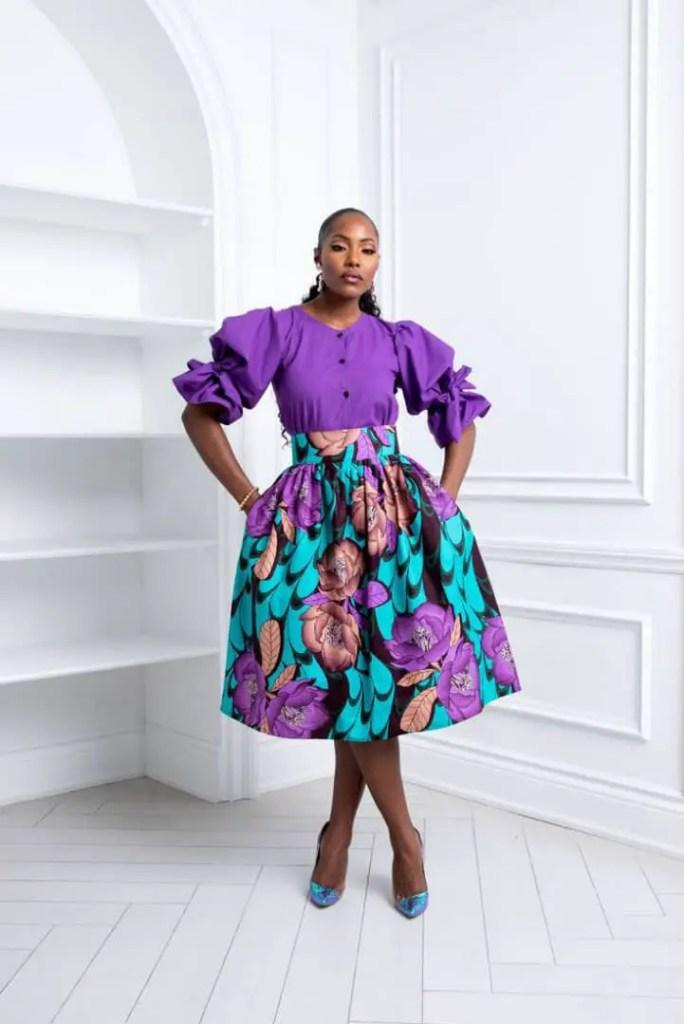 pretty lady wearing purple top plus ankara skirt