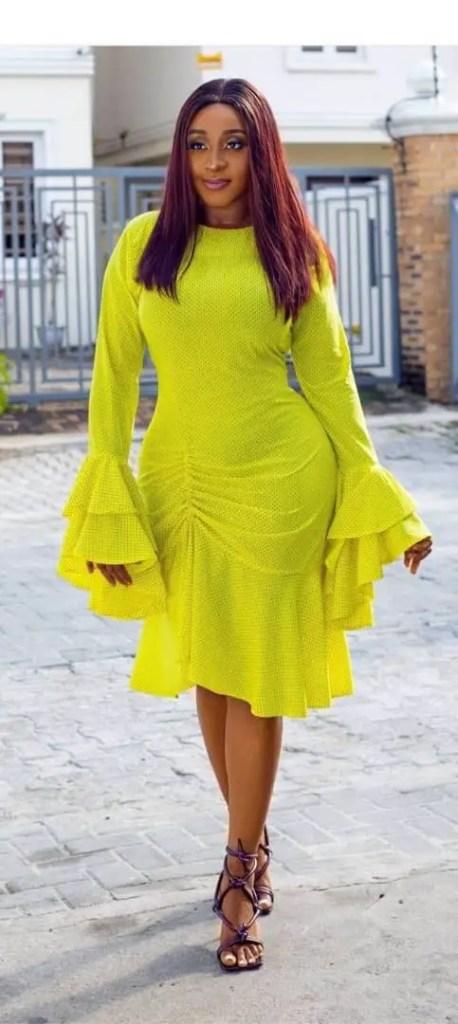 Ini Edo wearing bright yellow dress