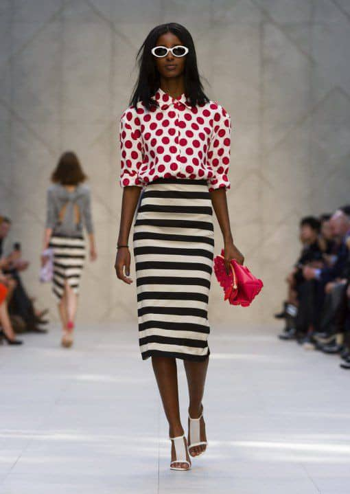 model combining different fabrics on the runway