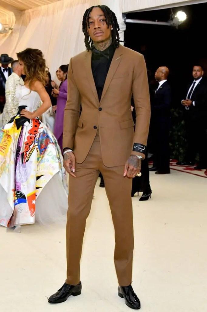 Wiz Khalifa attending a wedding in suit