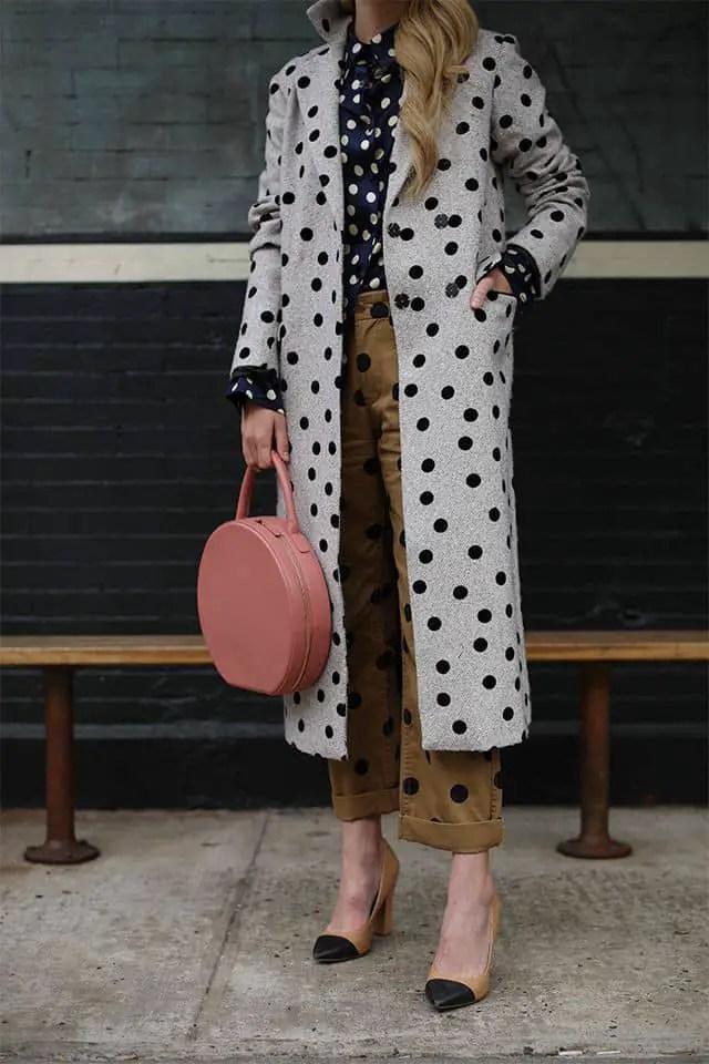 lady wearing mixed polka dots outfit