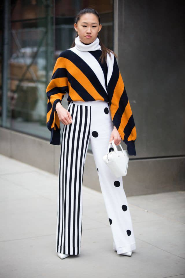 Asian lady mixing prints in her outfit