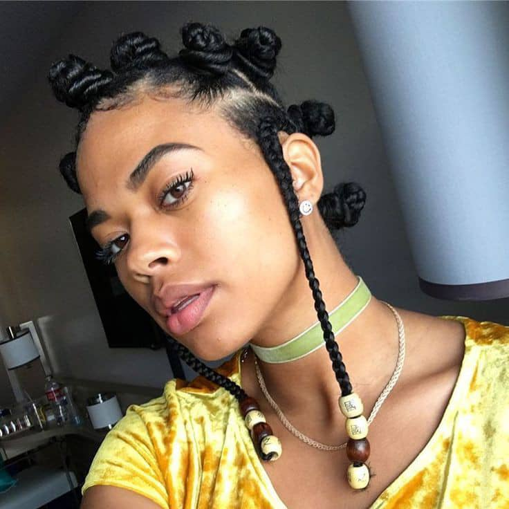 lady wearing Bantu knots with beads in the braids