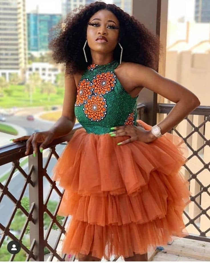 lady wearing ankara and organza dress for a party