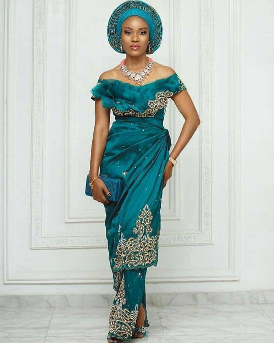 lady in green owambe outfit with matching gele