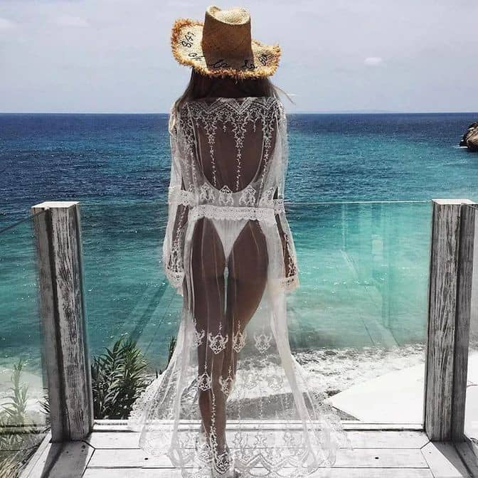 lady wearing white bikini under white sheer dress