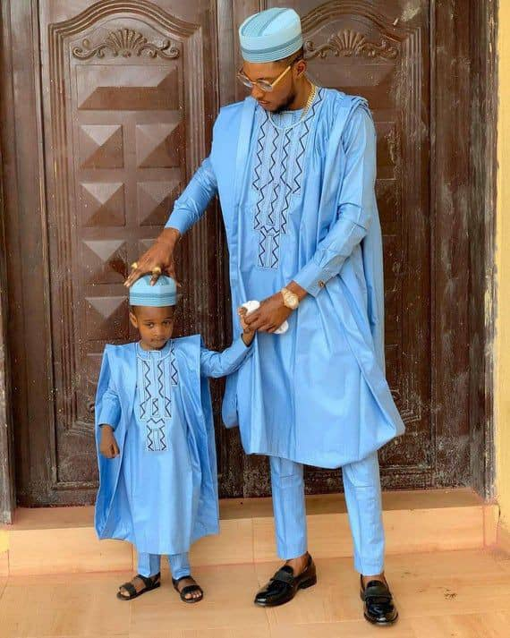 father and son wearing blue agbadas with match caps