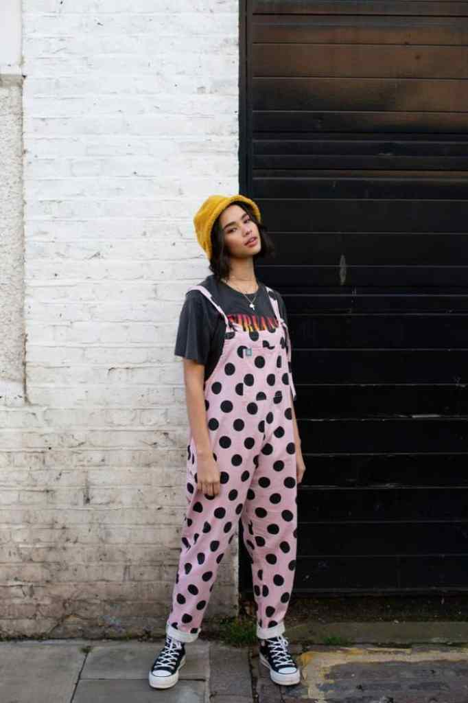 lady wearing dungaree with hat