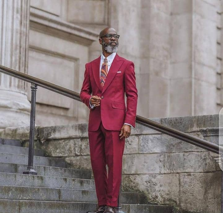 man in a red formal suit