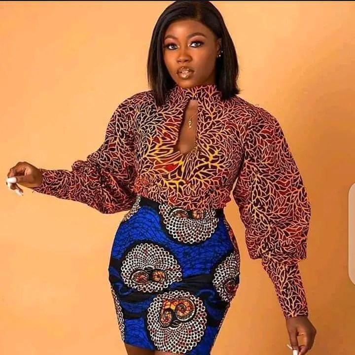 lady wearing mixed print ankara top and mini skirt