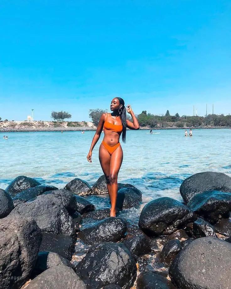 hot lady wearing orange bikini at the beach