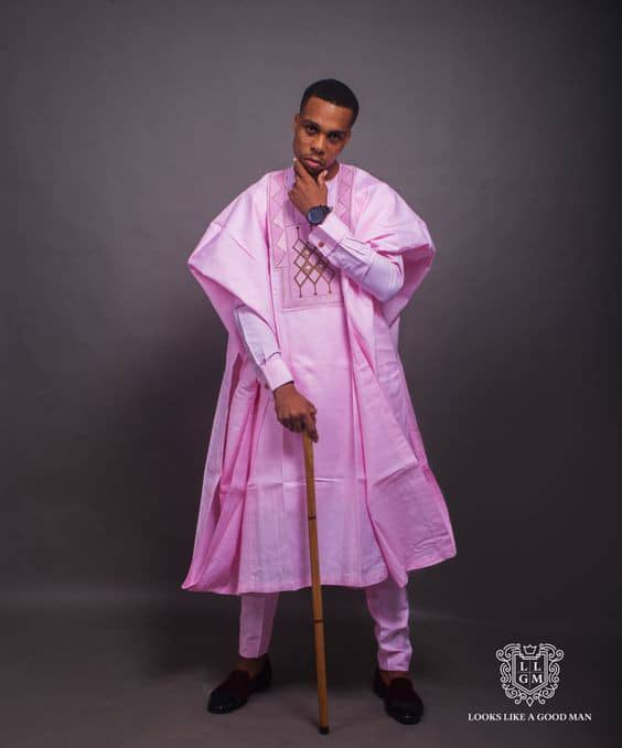 man wearing pink agbada to owambe event