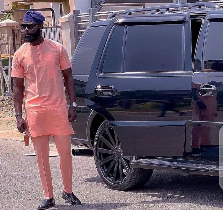 man wearing pink senator wear