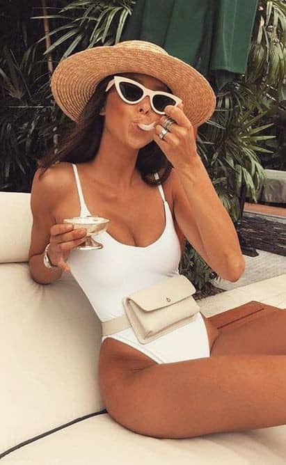 lady in white tankini with sunshades and hat