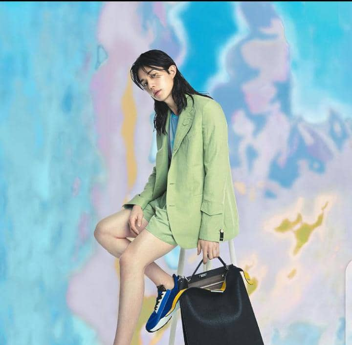 a model wearing a luxury fashion piece