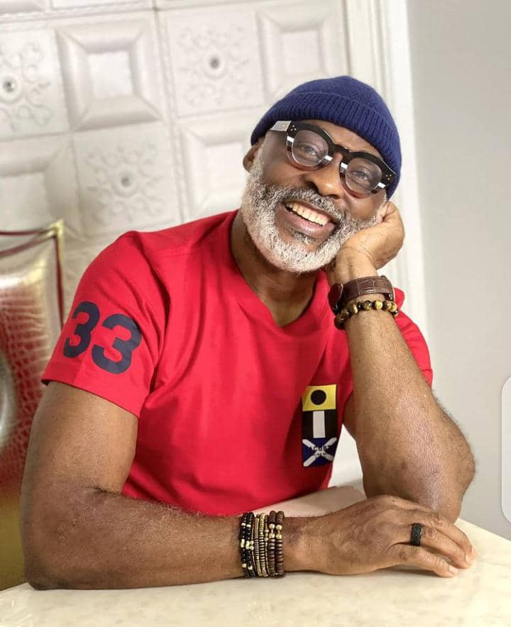 Richard Mofe-Damijo smiling in his streetwear outfit