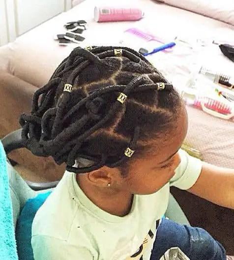 kid wearing threaded hair