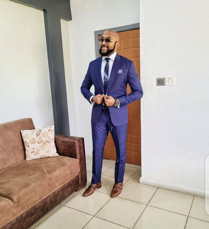 Banky W wearing suit with glasses
