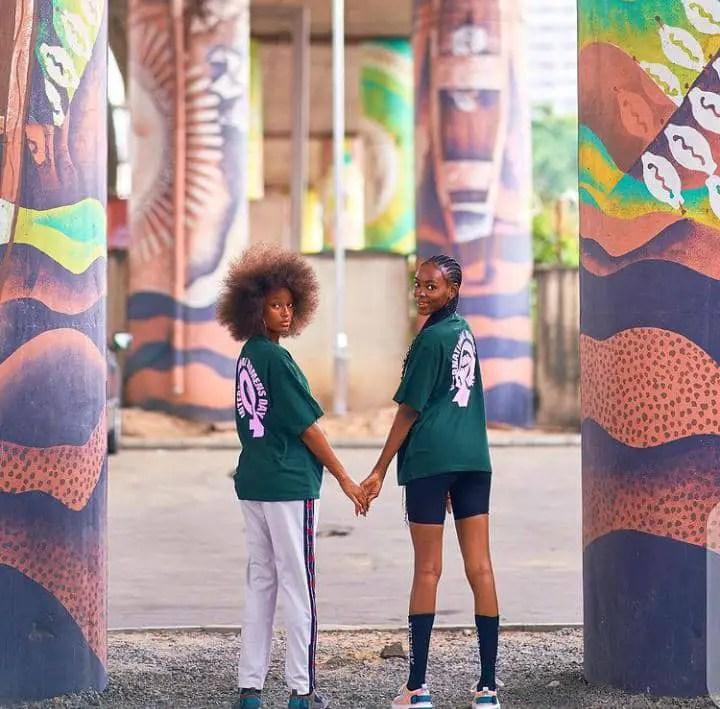 2 ladies wearing green T-shirts