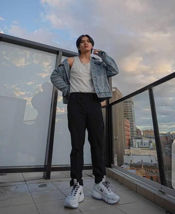 Asian man rocking jeans jacket