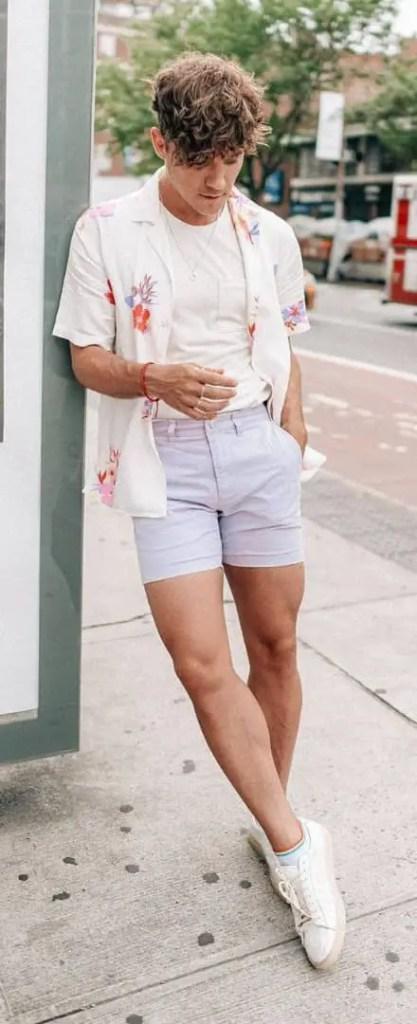 man layering shirt on white tshirt