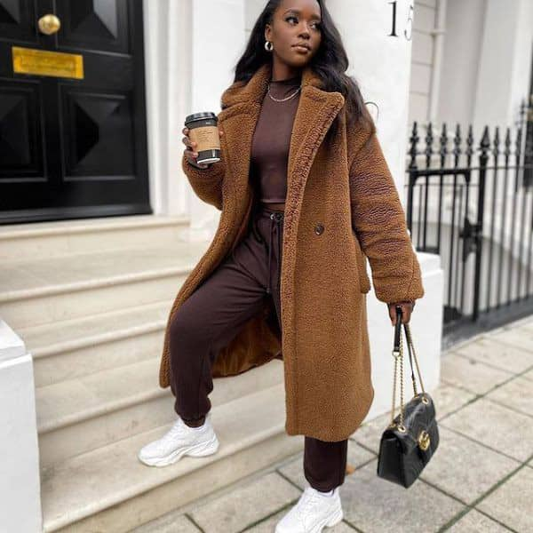 lady layering with an overcoat