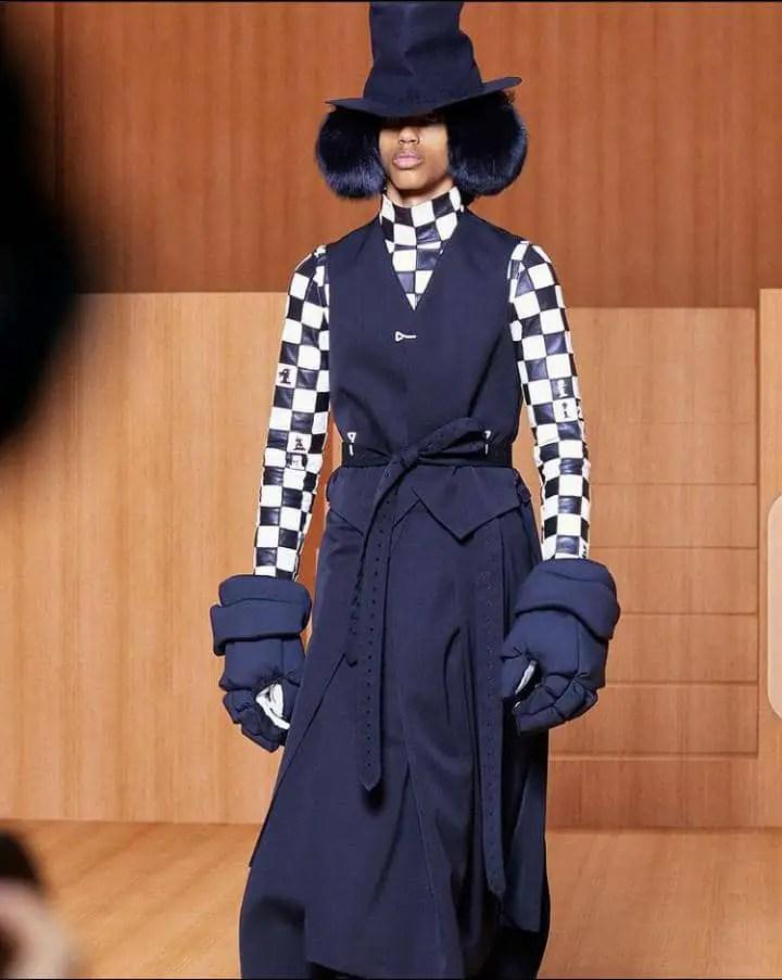 a model wearing Louis Vuitton dress on the runway