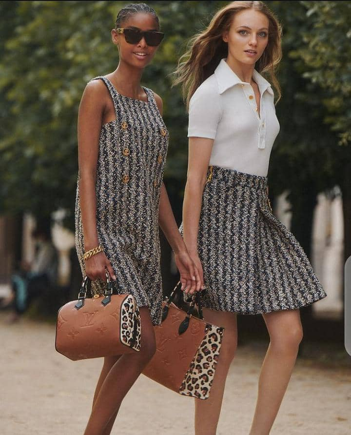 2 ladies wearing Louis Vuitton clothes and bags