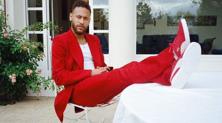 Neymar relaxing in a red casual suit